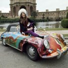 JANIS JOPLIN SITS ON HER PSYCHEDELIC 1965 PORSCHE 8X10 PUBLICITY PHOTO (EP-530)