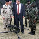 PRESIDENT GEORGE W. BUSH RECEIVES BRIEFING ON BROWNING GUN 8X10 PHOTO (AA-861)