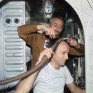 ASTRONAUT ALAN BEAN GETS A HAIRCUT DURING SKYLAB 3 - 8X10 NASA PHOTO (AA-088)