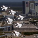USAF THUNDERBIRD F-16s FLY IN FORMATION PAST THE NASA VAB - 8X10 PHOTO (ZZ-103)