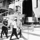 APOLLO 11 ASTRONAUTS GUIDED AROUND BASE OF SATURN V- 8X10 NASA PHOTO (BB-023)