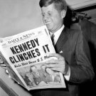 JOHN F. KENNEDY READS ABOUT 1960 PRES ELECTION VICTORY - 8X10 PHOTO (NN-117)
