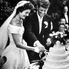 JOHN F. KENNEDY AND NEW WIFE JACQUELINE CUT WEDDING CAKE - 8X10 PHOTO (AA-796)