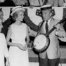 WERNHER VON BRAUN WEARING HAT AND HOLDING BANJO AT PICNIC - 8X10 PHOTO (DA-425)