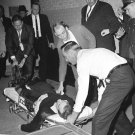 LEE HARVEY OSWALD ON STRETCHER AFTER BEING SHOT BY JACK RUBY 8X10 PHOTO (AA-931)