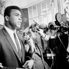 "MUHAMMAD ALI SAYS ""NO COMMENT"" TO REPORTERS AT 1967 TRIAL - 8X10 PHOTO (ZY-139)"