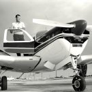 GORDON COOPER STANDS ON WING OF BEECHCRAFT BONANZA AIRCRAFT 8X10 PHOTO (AA-564)