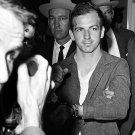 LEE HARVEY OSWALD AT DALLAS POLICE HQ ON NOVEMBER 22, 1963 - 8X10 PHOTO (AZ-032)