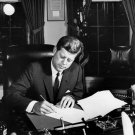 PRESIDENT JOHN F. KENNEDY SIGNS CUBA QUARANTINE ORDER 1962 - 8X10 PHOTO (BB-960)