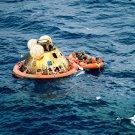 APOLLO 11 CREW AWAITS PICKUP BY USS HORNET HELICOPTER - 8X10 NASA PHOTO (ZZ-451)