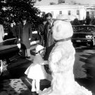 CAROLINE KENNEDY TOUCHES SNOWMAN MADE FOR HER AT WHITE HOUSE 8X10 PHOTO (BB-368)