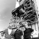 APOLLO SOYUZ TEST PROJECT CREW FRONT OF SATURN ROCKET - 8X10 NASA PHOTO (ZZ-522)
