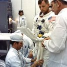 NEIL ARMSTRONG REVIEWS FLIGHT PLANS PRIOR TO LAUNCH - 8X10 NASA PHOTO (EP-381)