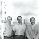 APOLLO 11 CREW STANDS NEAR SATURN V ROCKET - 8X10 NASA PHOTO (EP-504)