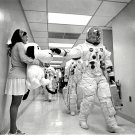 ASTRONAUT TOM STAFFORD PATS NOSE OF APOLLO 10 MASCOT SNOOPY 8X10 PHOTO (AA-183)