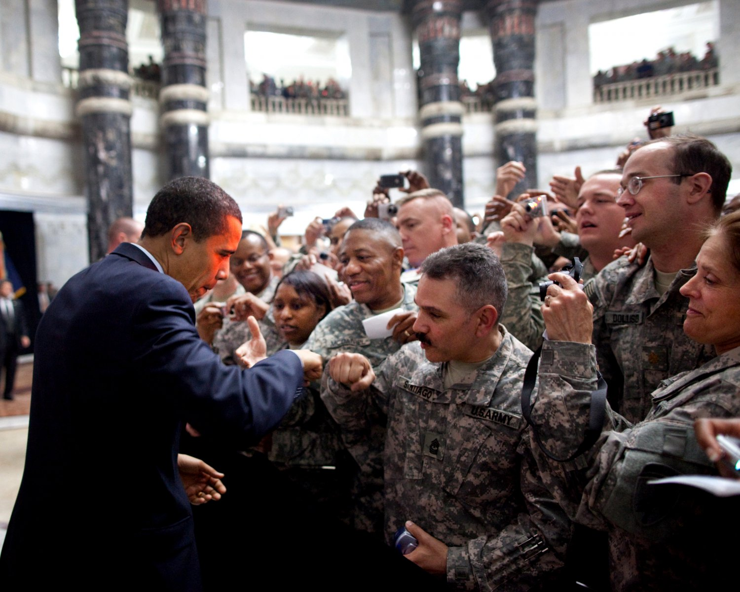 PRESIDENT BARACK OBAMA FIST-BUMPS WITH A SOLDIER IN IRAQ