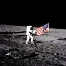 APOLLO 12 ASTRONAUT PETE CONRAD UNFURLS FLAG ON MOON - 8X10 PHOTO (BB-147)