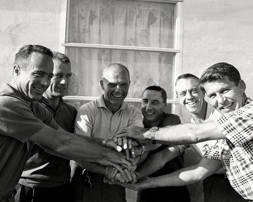 MERCURY ASTRONAUTS UNITED WITH HANDS CLASPED - 8X10 NASA PHOTO (AA-281)