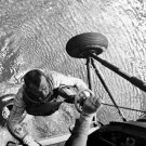 MERCURY ASTRONAUT ALAN SHEPARD HOISTED TO HELICOPTER - 8X10 NASA PHOTO (AA-246)