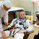 ASTRONAUT NEIL ARMSTRONG SUITS UP BEFORE GEMINI 8 - 8X10 NASA PHOTO (AA-378)