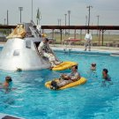 APOLLO 1 CREW PRACTICES WATER EGRESS PROCEDURES - 8X10 NASA PHOTO (ZZ-129)