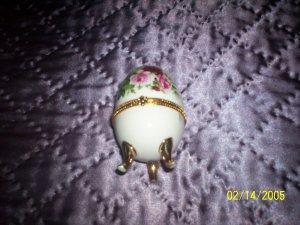 Egg shaped white trinket  w/ flowers