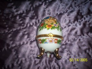 Egg shaped trinket w/ bunnies and flowers.j