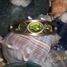 Brass bangle with green peridots