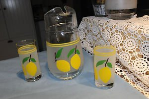 Vintage juice jug with two glasses. Lemon, frosted glass. No Name