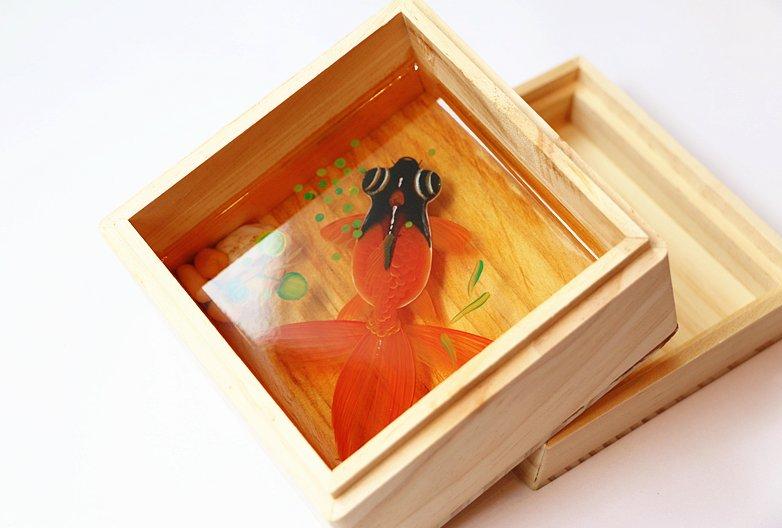 Black orange fish resin painting