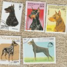 Lot of 5 Doberman Pinscher Dog Stamps Miniature Art