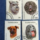 Lot of 4 Dogs Collectible Postage Stamps Tanzania Canine Miniature Art