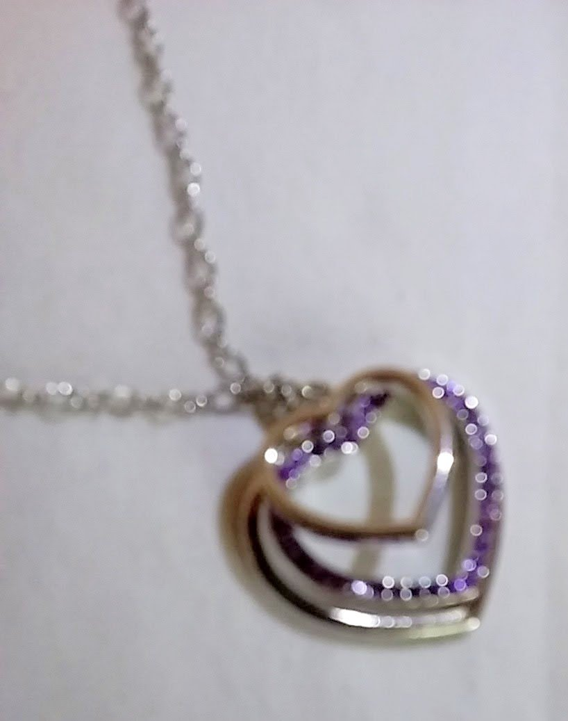 3 Hearts necklace with 2 heart pendants and one crystal purple heart. 18 inch chain