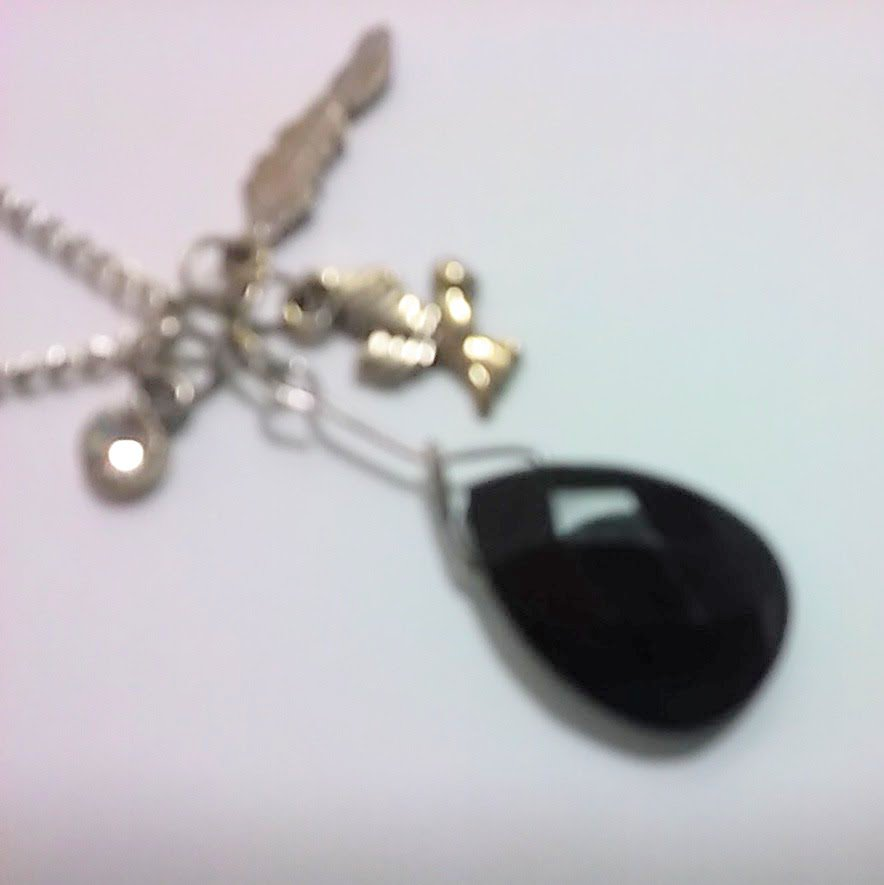 Antique style necklace with a feather, a bird, a rhinestone, and black jewel charms 18 INCH CHAIN