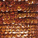 Sequin Trim Orange Hologram 8mm Cup Facet strung by the yard. Made in USA.