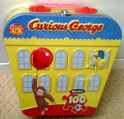 Curious George 100 Piece Puzzle in Collectible Carry Tin