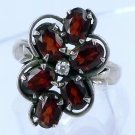 Size 7.5 Ring : Sterling 925 Silver With 6 Garnets and Clear Stone Center