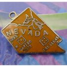 vintage ORANGE ENAMEL TRAVEL SOUVENIR MAP CHARM : NEVADE (UNMARKED)