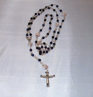 Blue Glass Rosary with Silver Plated Wrapped Horseshoe Nail Cross Pendant