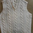 Unisex west. White color with cable design on front.