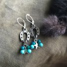 Silver tone horseshoe earrings #1