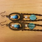 Bronze metal earrings with blue beads and chain