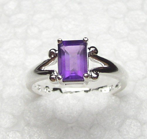 Sterling silver ring with an Emerald cut Amethyst Stone in size 8