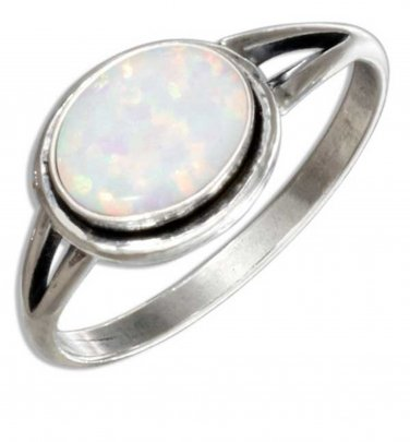 Sterling silver ring with a lab created Oval White Opal Stone in size 8