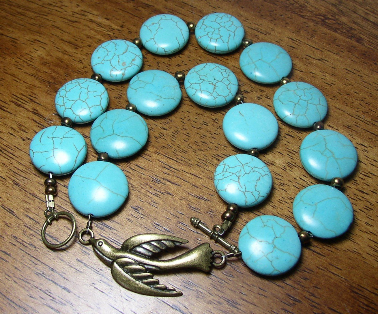 Turquoise Magnesite stone and brass bird 18 inch Necklace