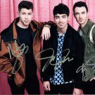 JONAS BROTHERS - ALL GROWN UP - WOW - HAND SIGNED AUTOGRAPHED PHOTO WITH COA