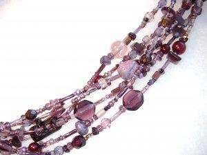 Six Strand Glass Bead Necklace - Purple hues