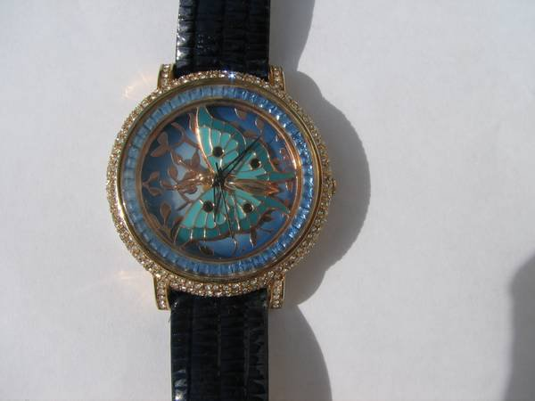 Luxury watch with blue and white cz stones
