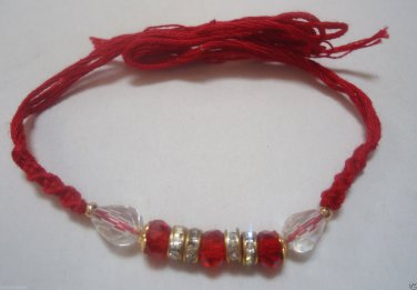 Rakhi in Glass Pearl With Coral & Crystal Clear Stones By Teknowear
