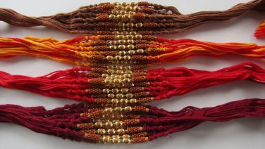 Tulsi/Basil Brown Beads Rakhi in Gold Tone With brown beads by Teknowear.